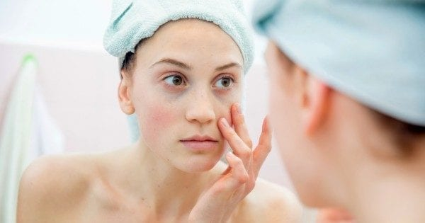 nose-surgery-young-woman-looking-in-mirror-istock-600x315